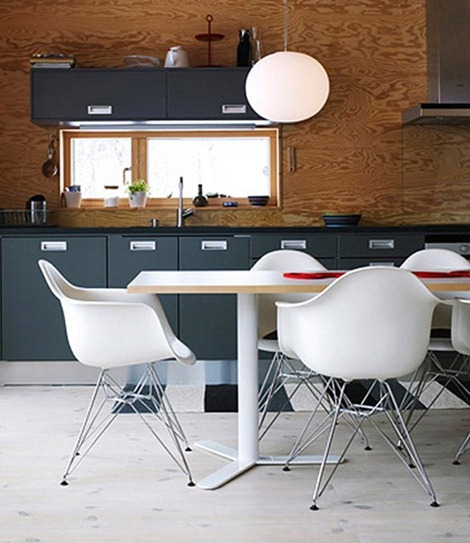gray-kitchen-white-chairs-wooden-walls
